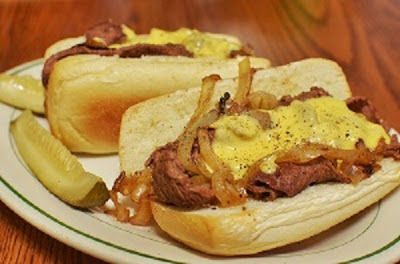 Cheesesteak sandwiches with pickles